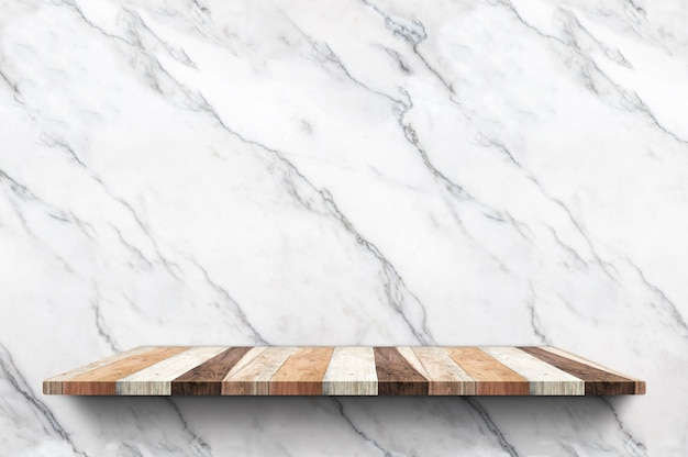 Empty wood plank shelf at white marble wall background