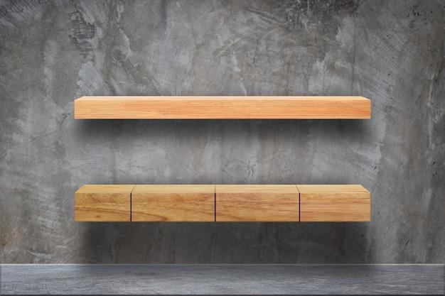Empty wood plank shelves on grunge concrete room background