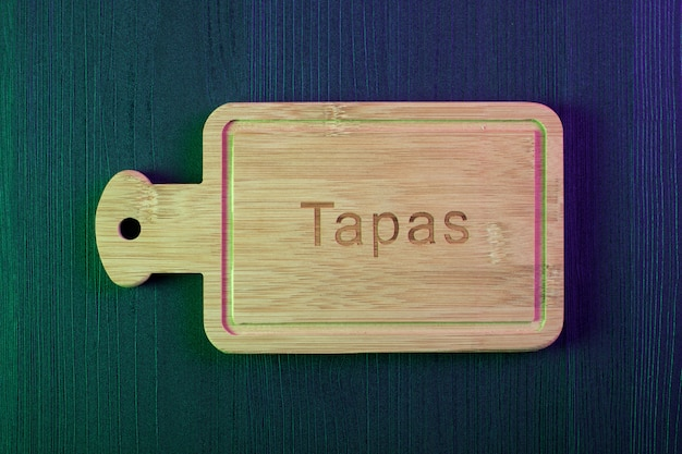 Empty wood plate on wood table. spanish tapa. copy space and top view