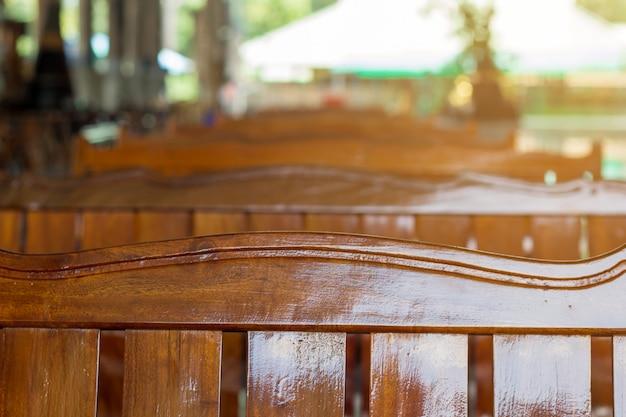 Empty wood sofa in row