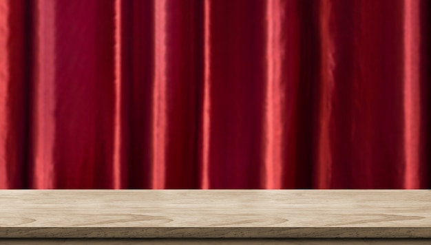 Empty wood table and blurred vivid red luxury curtain background.