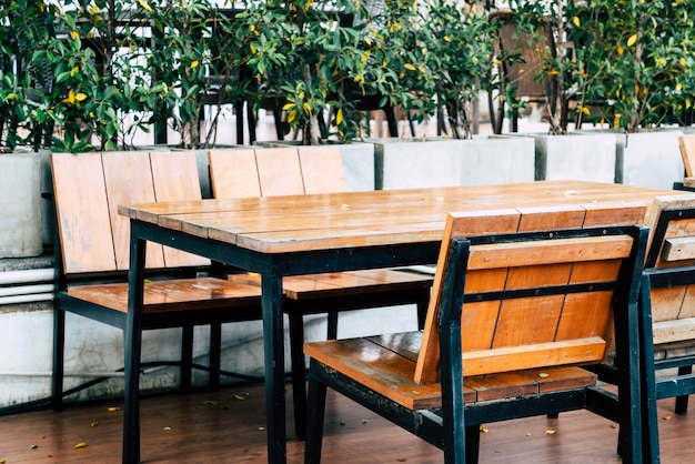 Empty wood table and chair in outdoor restaurant