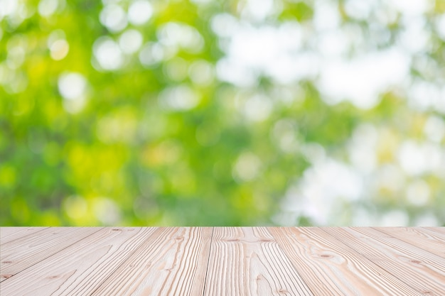 Empty wood table on green natural background