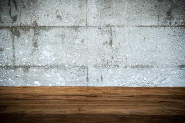 Empty wood table and grunge concrete style background.copy space for insert graphic and text objects.