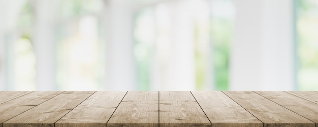 Empty wood table top and blur glass window interior restaurant