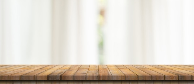 Empty wood table top on blur white window