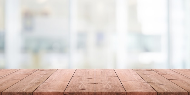 Empty wood table top and blurred abstract restaurant interior background