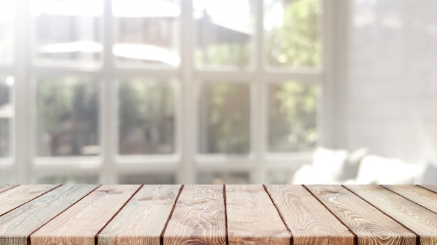 Empty wood table top and blurred bokeh cafe and restaurent interior background with vintage filter