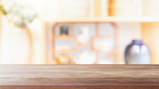 Empty wood table top and blurred restaurant interior background.