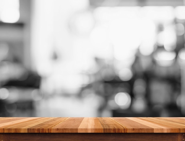Empty wood table top with blurred black and white cafe background