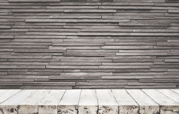Empty wood table top with brick wall background