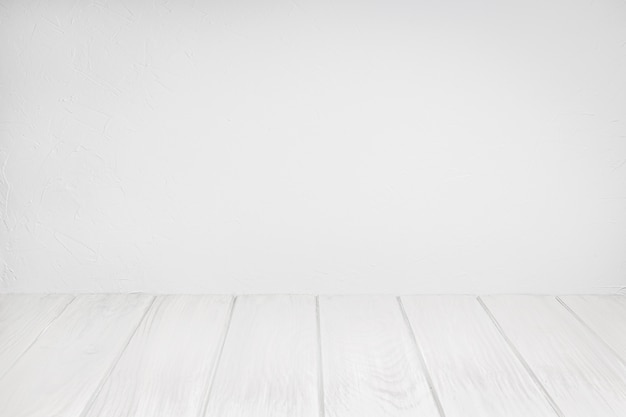 Empty wood table on white washed textured wall. white background for composition. copy space