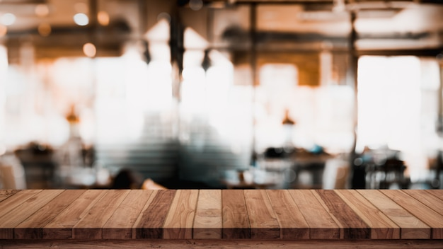 Empty wood table with blur cafe.