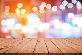Empty wood table with colorful abstract bokeh