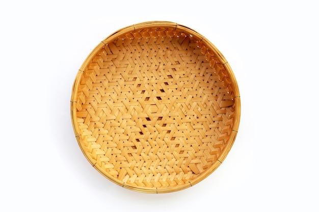Empty wooden bamboo basket on white background.
