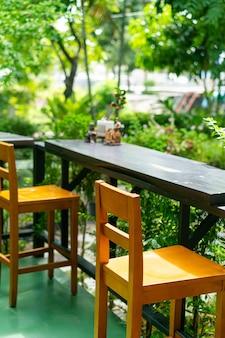 Empty wooden bar stool decoration in garden