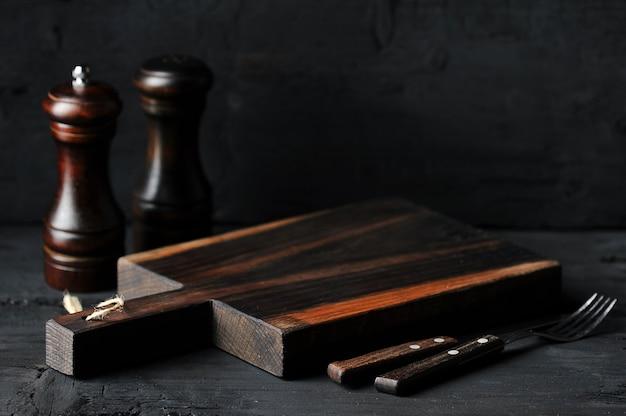 Empty wooden board, cutlery