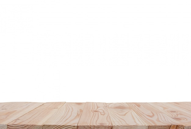Empty wooden board table top isolated on white background with clipping path and copyspace for display or montage your products