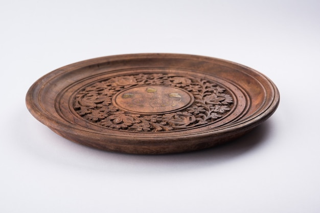 Empty wooden bowl or decorative wooden plate, isolated over white background