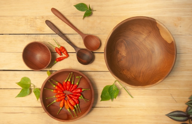 An empty wooden bowl on wooden background