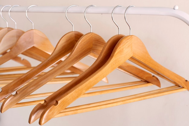 Empty wooden clothes hangers on aluminum rail
