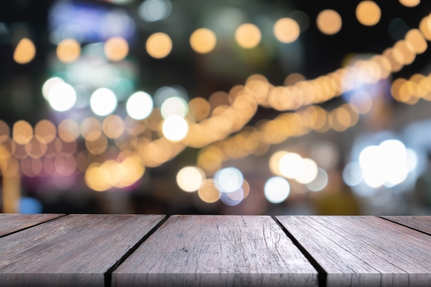 Empty wooden countertop with bokeh lights