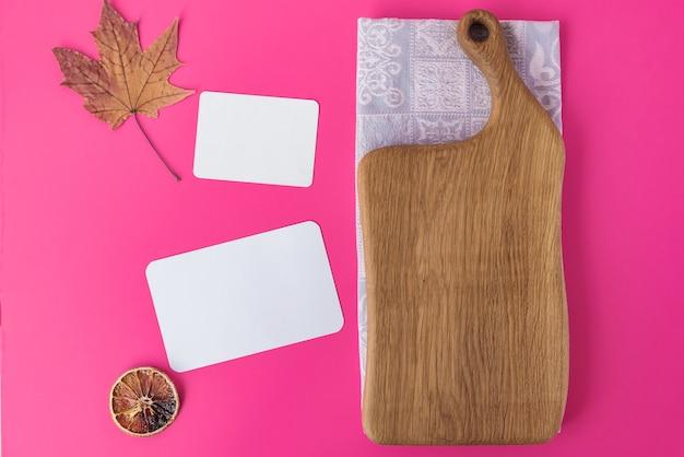 Empty wooden cutting board on cotton napkin