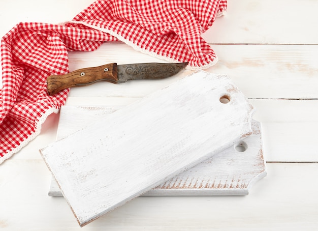 Empty wooden cutting board and old knife