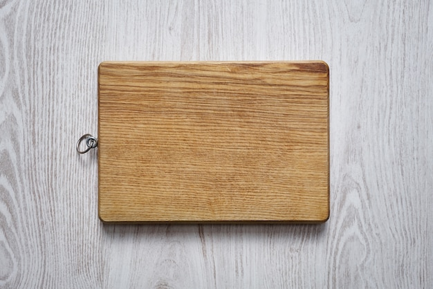 Empty wooden cutting board top view