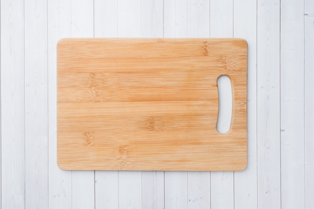 Empty wooden cutting board on a white background copy space