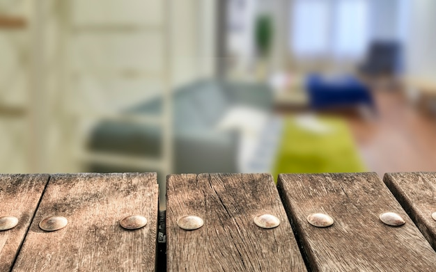 Empty wooden deck table on blurry hotel room background. can be used for mockup products displays