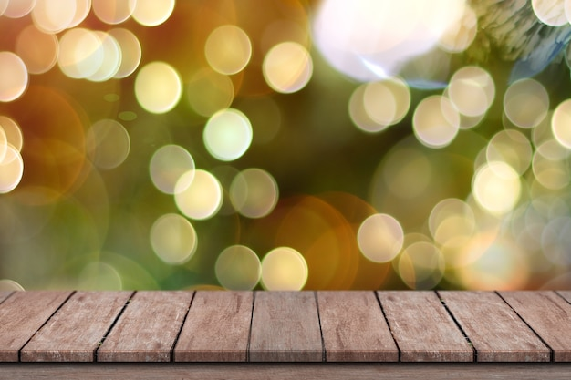 Empty wooden deck table over bokeh lights for product montage