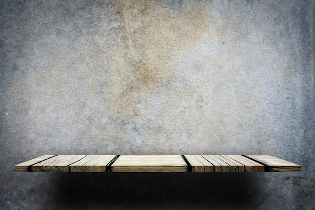 Empty wooden display counter on gray background