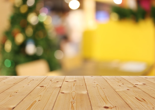 Empty wooden floor of plank table and bokeh lights of christmas background.