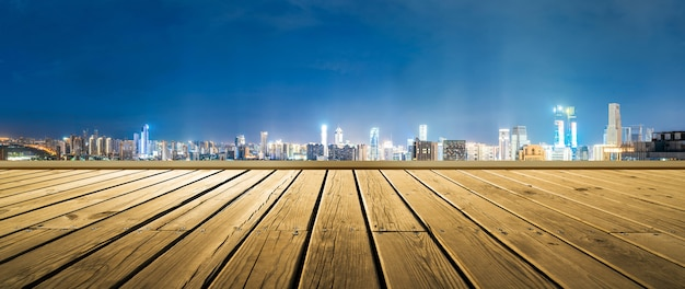 Empty wooden floor with cityscape of hangzhou at twilight