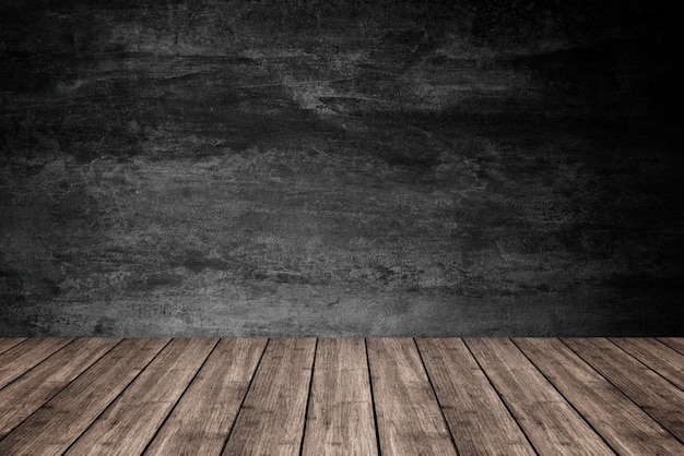 Empty wooden floor with dark concrete wall background, for product display.