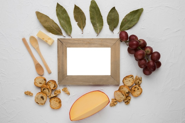 Empty wooden frame surrounded by tasty ingredient