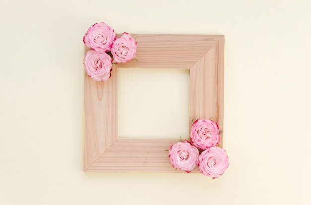 Empty wooden frame with roses