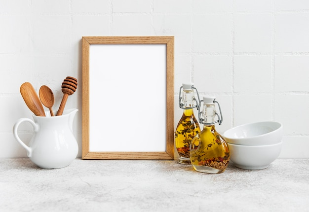 Empty wooden frame with  white surface in kitchen interior