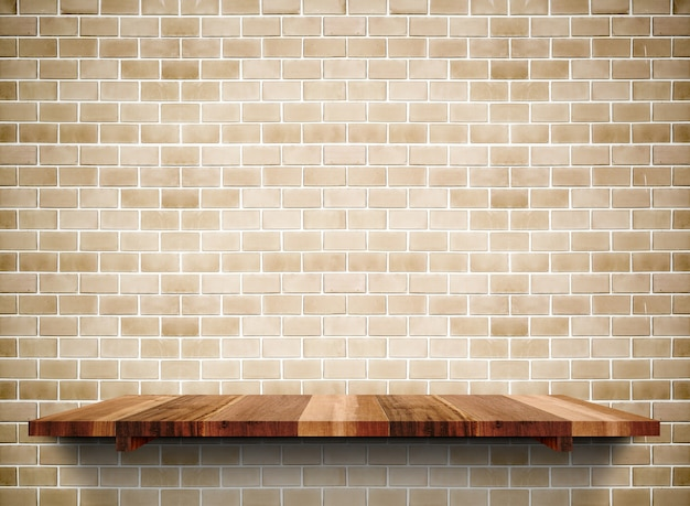 Empty wooden shelf on grunge brick