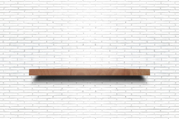 Empty wooden shelf on old white brick wall texture. for display products.