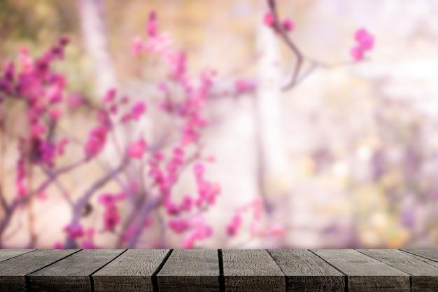 Empty wooden shelf on sakura background for product display