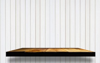 Empty wooden shelves on wooden wall