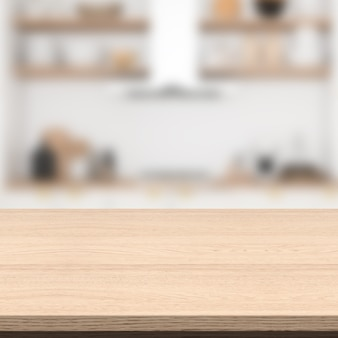 Пустой деревянный стол и размытый фон кухни.