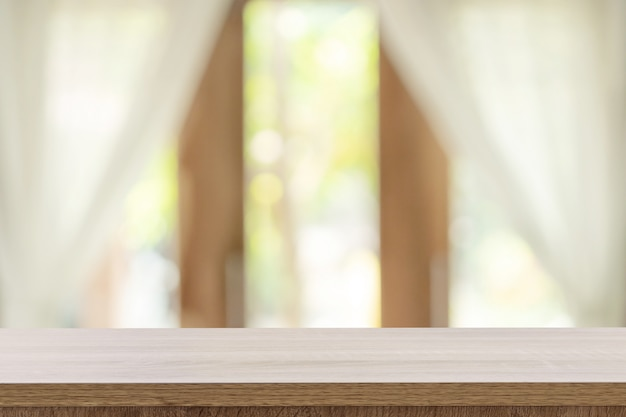 Empty wooden table and blur window background with copy space, display montage for product.