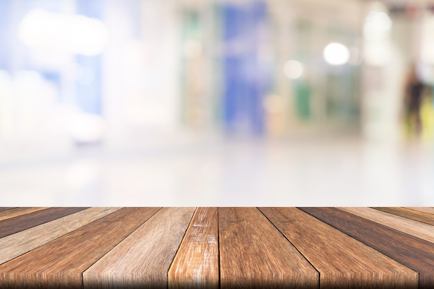 Empty wooden table of brown on front blurred colorful background