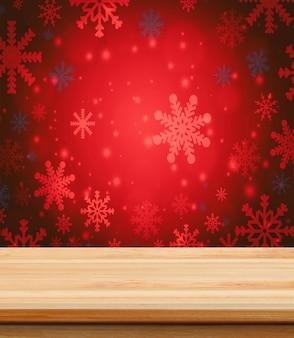 クリスマスの壁紙の背景と製品の配置のための空の木製のテーブル