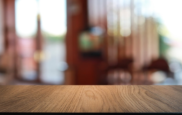 Empty wooden table in front of abstract blurred background