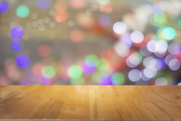 Empty wooden table in front of abstract bokeh background . can be used for display or montage your products.mock up for display of product. for christmas, new year celebration.