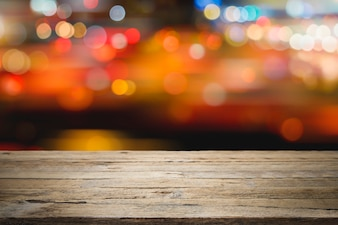 Empty wooden table platform and bokeh at night for product display montage.